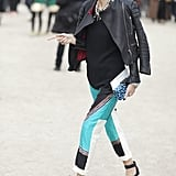 A moto jacket toughened up printed trousers and statement baubles.