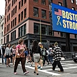 "An electronic billboard read ""Boston Strong"" near the finish line."