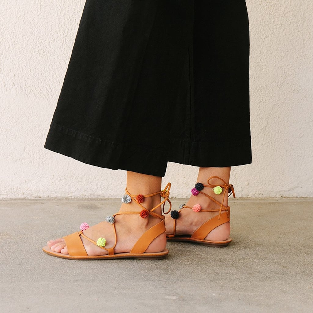Don't be distracted by the playful pom-poms on Loeffler Randall's Saskia Sandal ($250). The strings are secured at all the right places around your foot, and the bonus is these babies go with everything in your wardrobe from culottes to a swimsuit and caftan.