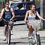 Miley Cyrus and Liam Hemsworth rode bikes around Toluca Lake in March 2010.