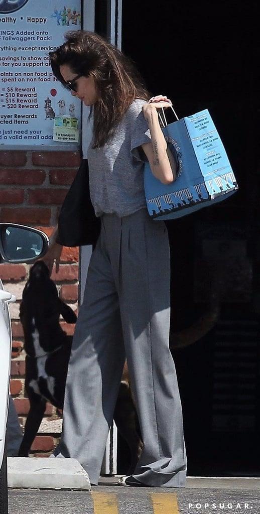 Angelina Jolie Wearing Gray Trousers