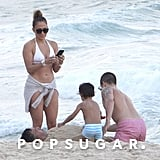 Jennifer Lopez showed off her fit physique in a white bikini when she hit the beach in Rio de Janeiro with Casper Smart and her son, Max, in June.