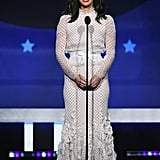 Wearing a ruffled Giambattista Valli gown that featured polka dots. She accessorized with Djula jewels and Gianvito Rossi shoes.