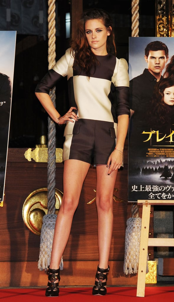 Checkmate! Stewart struck a sultry pose in a checkered Louis Vuitton romper and buckled cage sandals on a 2012 promotional tour of Breaking Dawn Part 2 in Tokyo in October 2012.