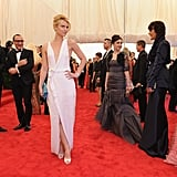 Hugh Dancy and J. Mendel designer Gilles Mendel watched as Claire Danes struck a pose in the middle of a crowded carpet.