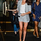 Meghan layered a fancy white tee underneath a striped shorts suit, complete with taupe pumps, for an appearance at the Today Show in July 2016.