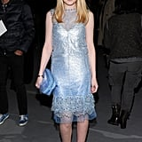 Dakota Fanning took front row at Marc Jacobs in a sparkly sheath.