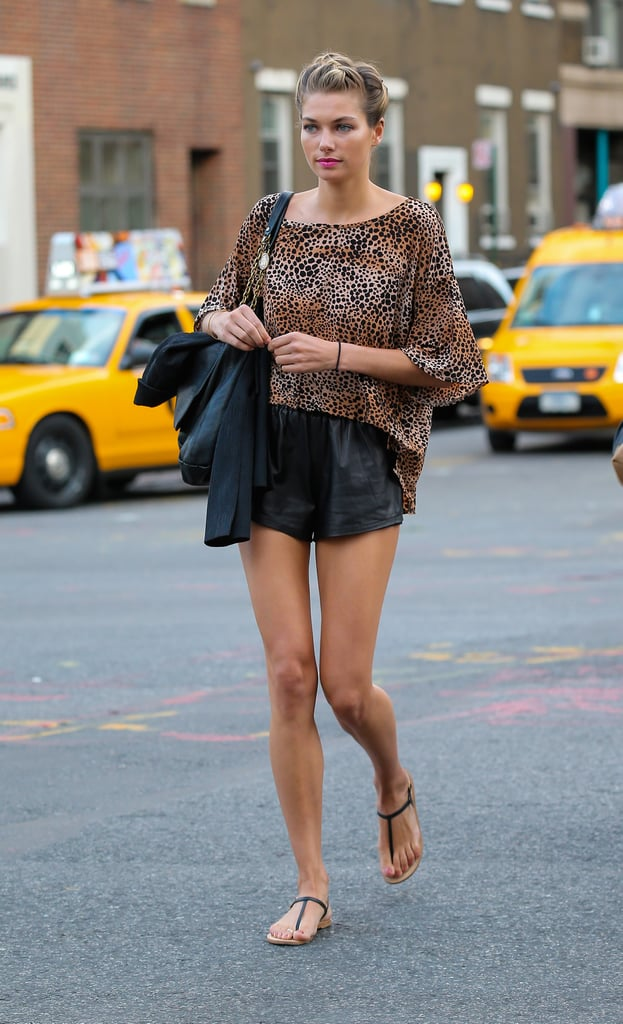 Off-duty street style, perfected. Jessica Hart's legs go for miles thanks to gym-style shorts cut on an angle, and a loose-fitting top balancing out the ensemble. Super simple sandals let the upper half of her outfit do all the talking