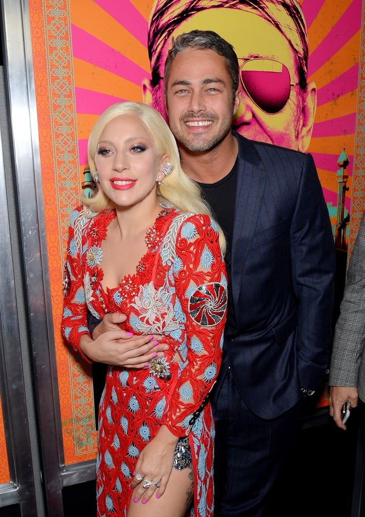 Lady Gaga and Taylor Kinney couldn't keep their hands off of each other as they hit the red carpet for the NYC premiere of Rock the Kasbah on Monday night. The couple, who got engaged in February and have been gushing nonstop about their relationship recently, were the picture of love as they posed for photos together, holding hands and sneaking in a few kisses. Taylor stars in the film alongside Bill Murray, Kate Hudson, and Zooey Deschanel, who were all in attendance. It's just the latest in a slew of adorable public moments we've seen from the two over the past few weeks; Taylor supported his lady at the premiere of her show American Horror Story: Hotel, and was also by her side when the singer touched down in the Big Apple in style last week. Keep reading for Taylor and Lady Gaga's sweet red carpet date, then check out more pictures of their PDA over the years.
