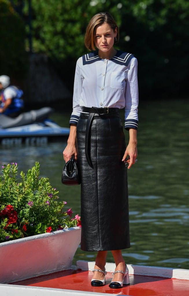 Emma Corrin Wears a Sailor Shirt and Leather Skirt