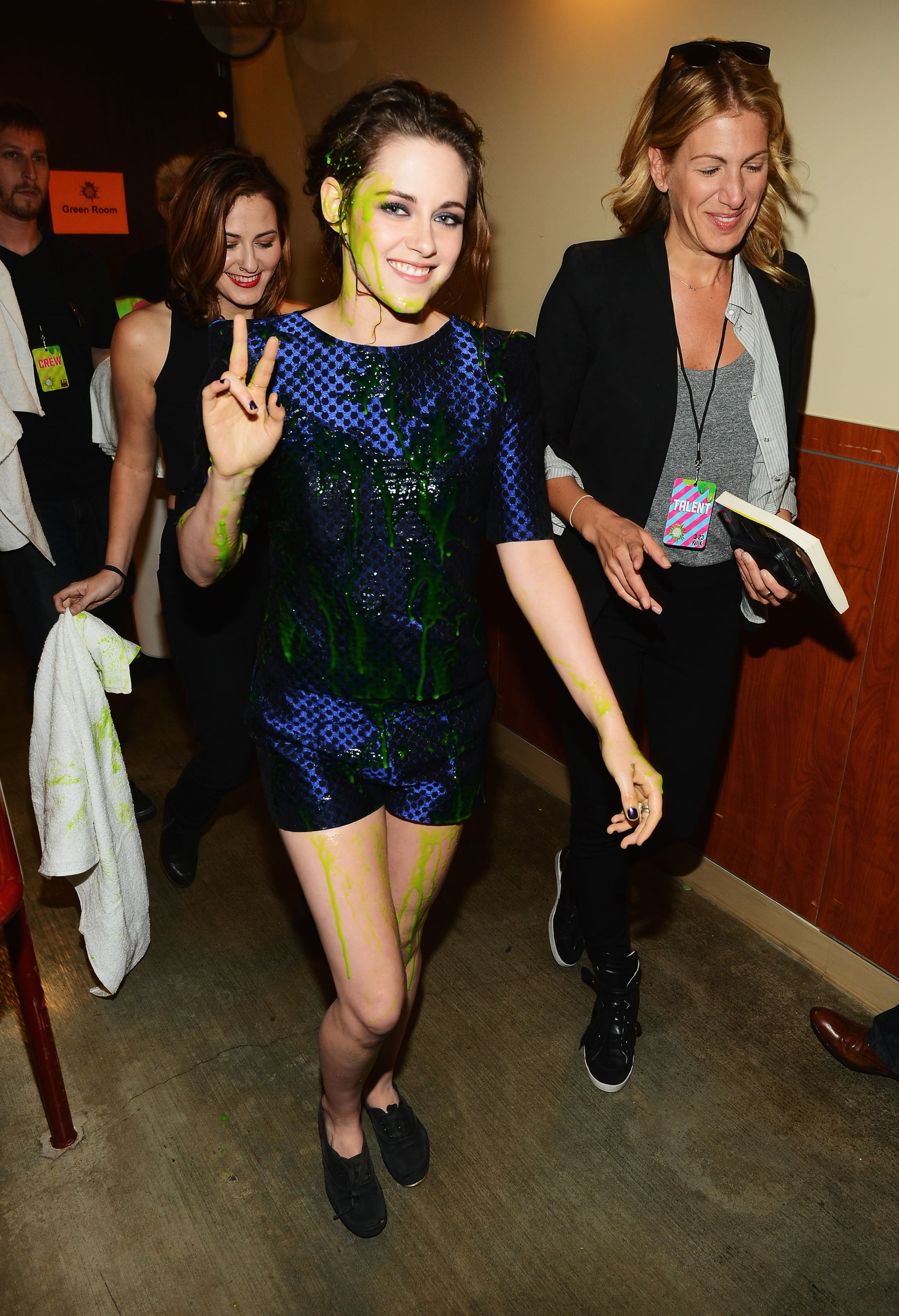 Kristen Stewart looked stunning in slime after winning the favorite actress award at the Kids' Choice Awards in LA in March.