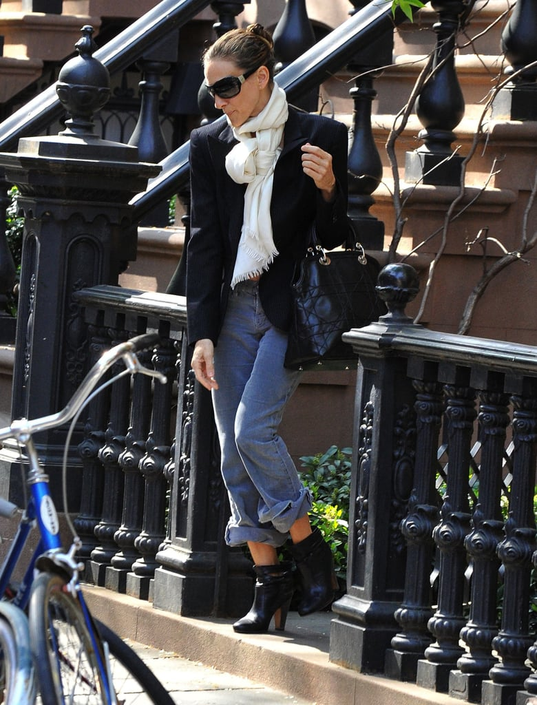 While exiting her NYC apartment one morning, Sarah Jessica Parker looked casual chic in a black blazer, relaxed jeans, black booties, and a Dior bag. A white scarf added much-needed brightness to her city look.       Tanks by BobiHobos by Christian Dior