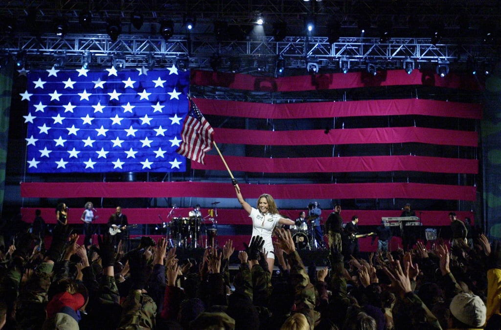 Jennifer Lopez waved an American flag at a December 2001 concert for the troops in Germany.
