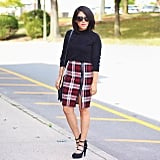 A Black Shirt, a Plaid Skirt, and Heels