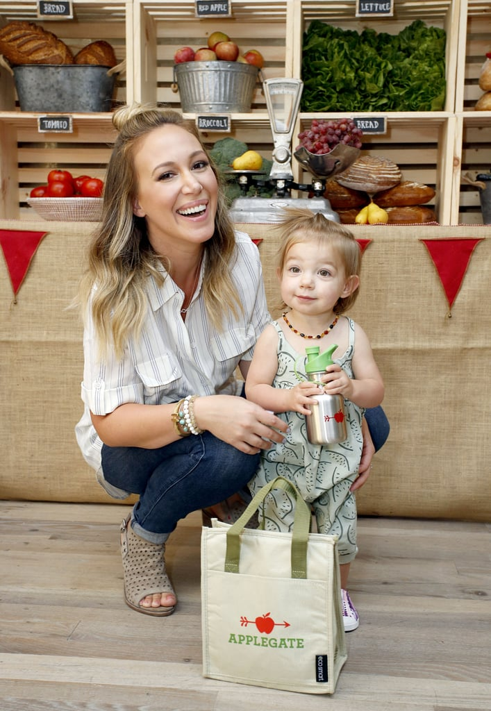 """Haylie Duff and her 1-year-old daughter, Ryan Rosenberg, attended Applegate's Sandwich Soiree in LA on Thursday. The event was held at Jessica Biel's new kids' restaurant Au Fudge and also brought out Haylie's mom, Susan, who shared a hug with her eldest daughter in between bites. Haylie held on to her wriggly little girl as they posed for a few photos; though The Real Girls Kitchen host recently revealed to POPSUGAR that Ryan is """"getting to the stage where we're throwing everything,"""" she seemed to have a fun time checking out the fresh produce and holding on to her own aluminum water bottle. Haylie and her fiancé, entrepreneur Matt Rosenberg, sure have a cutie on their hands.       Related:                                                                                                           Warning: You Will Definitely Want to Cuddle With Haylie Duff's Daughter, Ryan"""