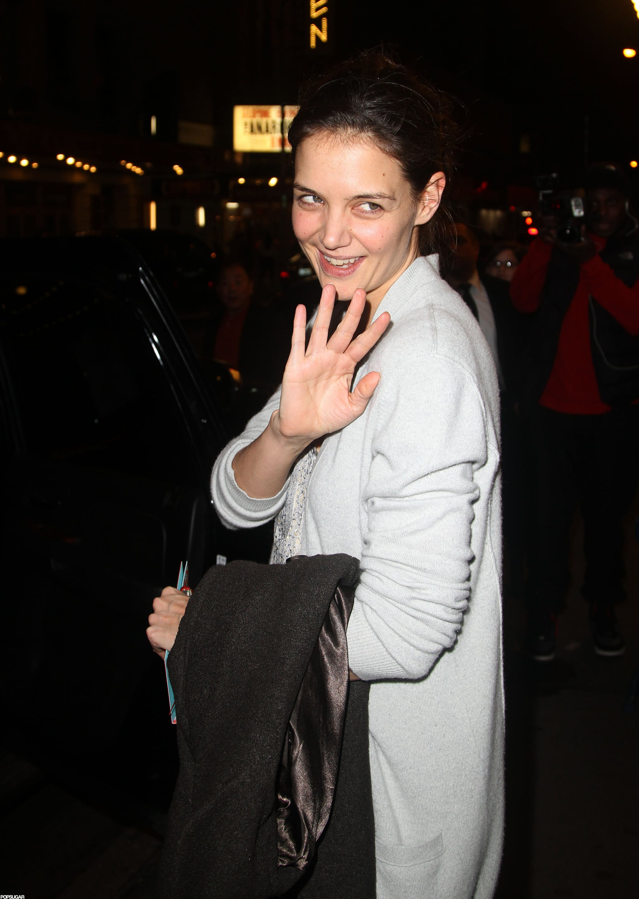 Katie Holmes gave a wave as she left her Broadway show.