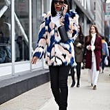 With a Bright Colored Faux-Fur Coat, a Clutch, and Black Booties