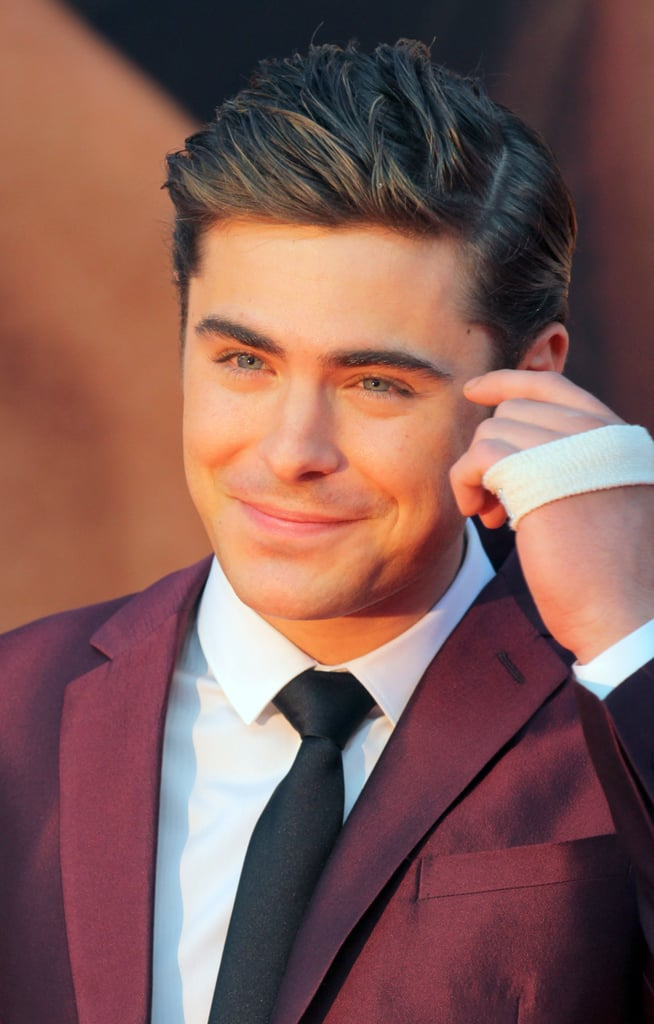 Zac Efron sported a bandage on his hand at the premiere of The Lucky One in Germany.