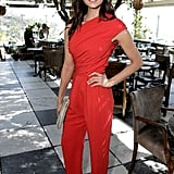 Nina Dobrev was red hot in her one-shoulder Max Mara jumpsuit, gold peep-toe Jimmy Choo wedges, and a Devi Kroell clutch at the luncheon.