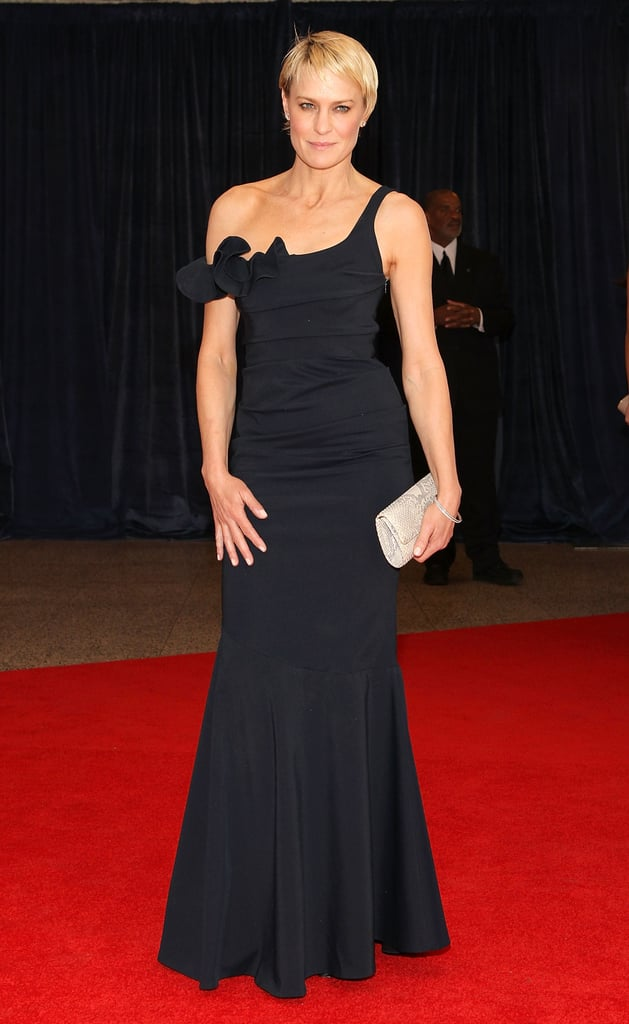 At the White House Correspondents' Dinner this year, Wright revealed her toned arms in a one-shouldered Rolando Santana Atelier gown.