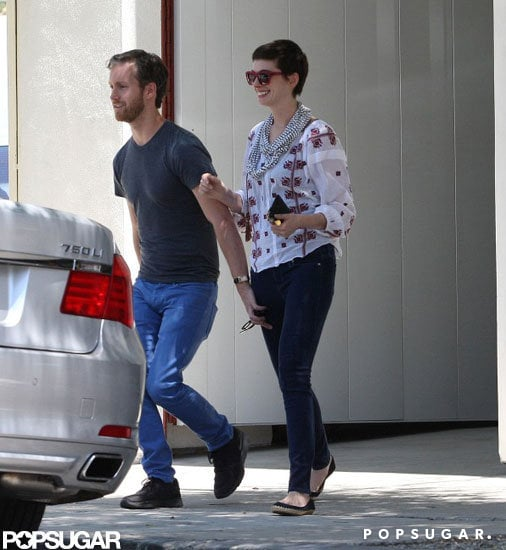 Adam Shulman led the way for Anne Hathaway coming out of a furniture store in LA.