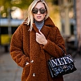 Style Your Coat With a Turtleneck and Quilted Bag