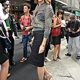 Carine Roitfeld worked her visor-style shades with a sporty, zippered jacket and a pencil skirt at Dolce & Gabbana's show.