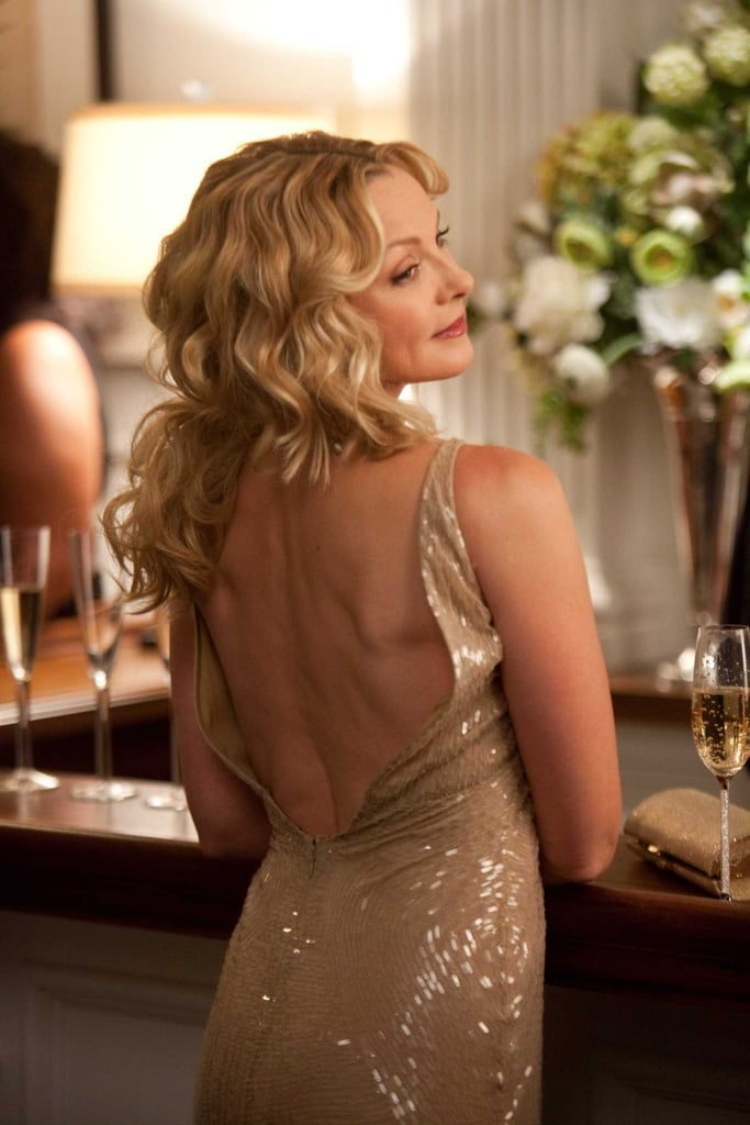 Backless, sequined, and a glass of Champagne nearby — it's quintessential Samantha Jones.