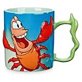 Our favorite sassy crab comes alive in this Sebastian Mug ($17).