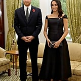 While in New Zealand, she stunned in a bespoke Gabriela Hearst midi dress when she and Prince Harry attended a reception at Government House, where she spoke at the podium to celebrate the 125th anniversary of women's suffrage in the country.