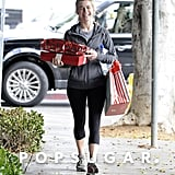 Julianne Hough rocked workout clothes and juggled a handful of gifts while walking around LA.