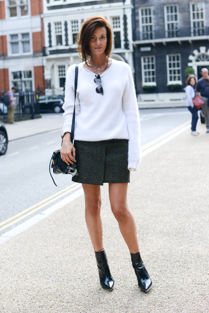 Blogger Hedvig Opshaug juxtaposed a luxe white topper with a tweed miniskirt.