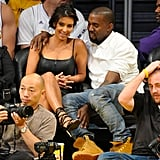 Kim Kardashian and Kanye West got cosy while taking in an LA Lakers playoff game at the Staples Center in May 2012.