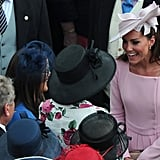 Kate Middleton greeted guests with a smile at Buckingham Palace.