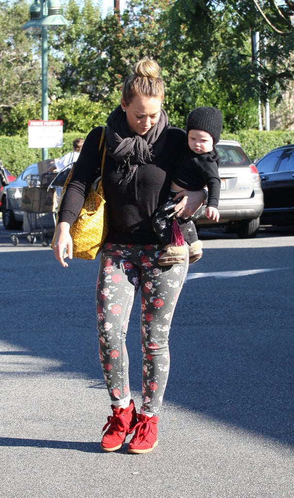 Hilary Duff carried baby Luca Comrie as she stopped by a grocery store in LA.