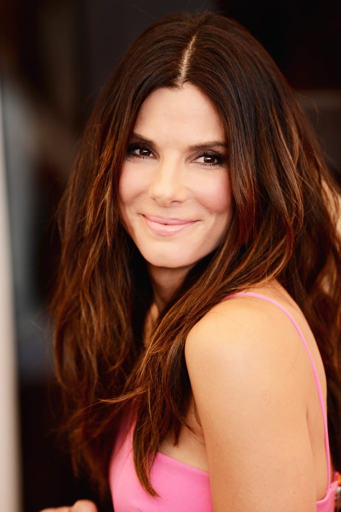 Sandra Bullock stepped out for the Gravity photocall in a bright colorblock dress. She complemented the daytime look with tousled hair and pink lips and cheeks.