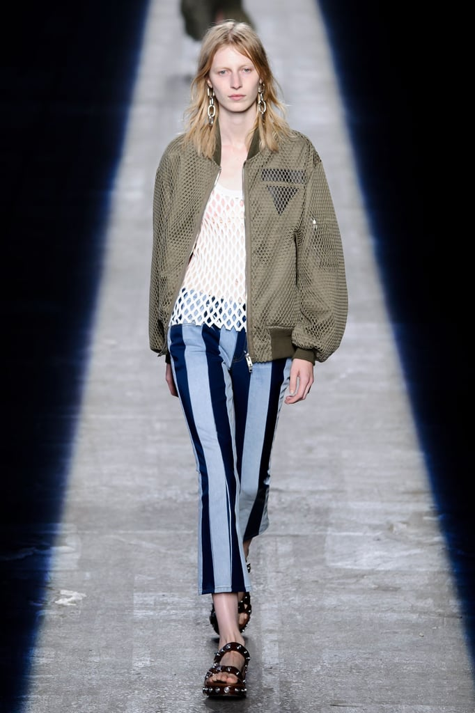 An army jacket and printed trousers.