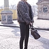 A Fab fur chubby and leather pants are spot-on city chic.