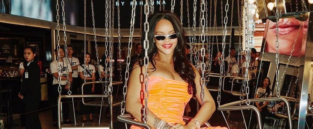 Rihanna Wearing Orange Dress While Sitting on a Carousel