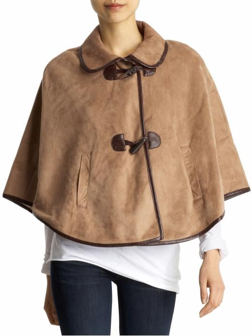Stay prepared for Spring's moody weather with a chic cape. Hive & Honey Shearling Toggle Cape ($48)