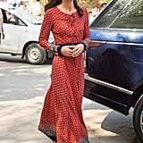 Glamorous in Mumbai: For another daytime engagement it was a red and navy maxi­dress with her go-to gold Accessorize earrings, and flats from Russell and Bromley.