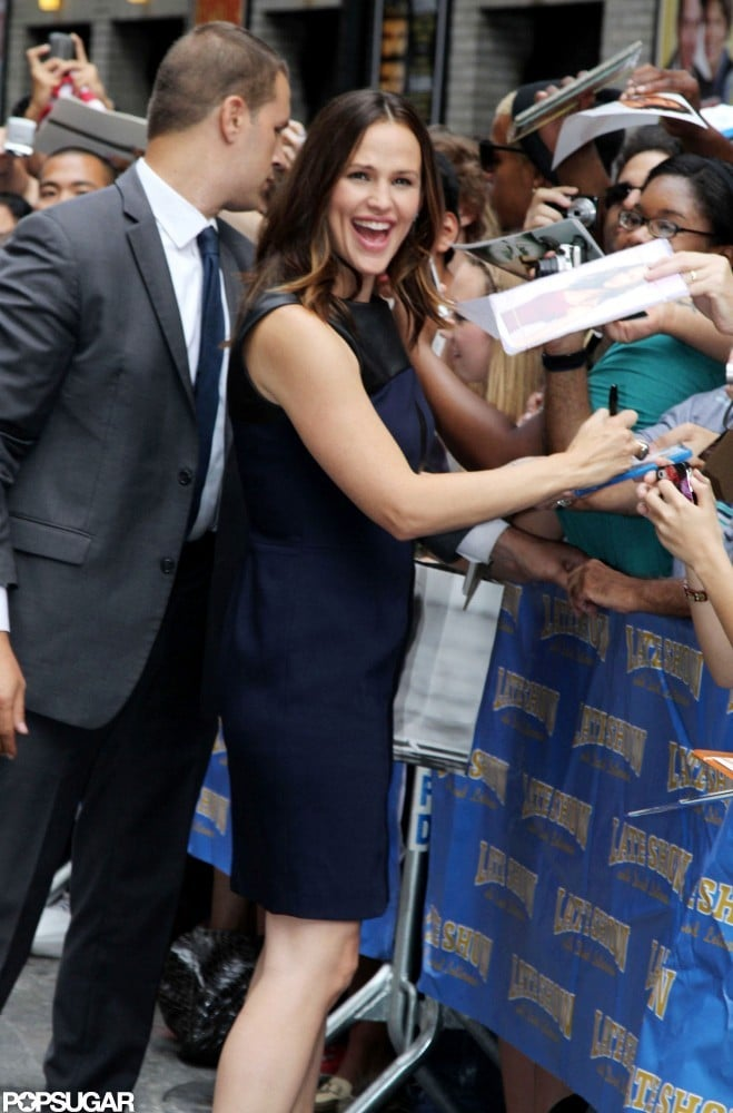 Jennifer Garner picked up a treat from the Prada store in NYC this morning and then changed into a navy dress for a busy afternoon. She fit in a shopping trip before getting started on a string of promotional appearances for The Odd Life of Timothy Green this week. Jennifer stopped by Late Show With David Letterman, where she greeted fans outside and met with the US Olympic women's gymnastics team backstage. She also posed at Sirius XM studios before attending a screening of her film. Her East Coast trip hasn't been just about work, though, since Jennifer was able to meet up with pal Victor Garber at his solo cabaret show. She also has her son, Samuel, to keep her company in the Big Apple. He wasn't by her side this afternoon, however, when she ventured out from her hotel wearing a blue dress.