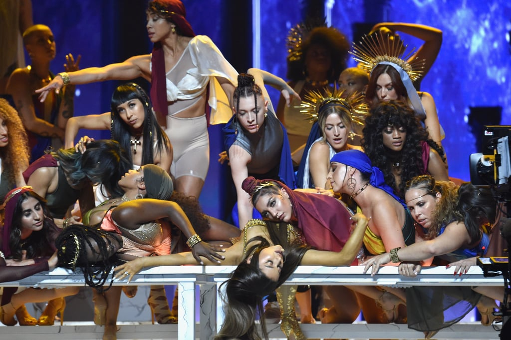 "If you found yourself hypnotized by the trippy music video for Ariana Grande's ""God Is a Woman,"" then prepare to be left breathless by her performance at the MTV VMAs. Grande, who just released her new album, Sweetener, hit the stage at the award show accompanied by a group of more than 50 female dancers, who broke it down at a Last Supper-esque tableau. In the lead-up to her performance, sources told The Hollywood Reporter that her set would be ""nothing short of God-like,"" and we have to agree. Check out the Moon Person winner's performance for yourself ahead, and make sure you watch until the final few seconds, because Grande brings out some truly adorable guests — her cousin, mother, and grandmother!      Related:                                                                                                           Everyone Who Took Home a Moon Person at the VMAs This Year"