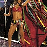 Tyra Banks donned a colourful cape on the runway in 2005.