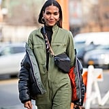 Styling a belt bag crossbody over a boiler suit is a fashion-forward take on functional.