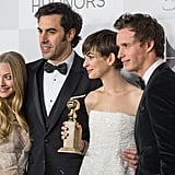 Anne Hathaway posed with Sacha Baron Cohen, Amanda Seyfried and Eddie Redmayne on the red carpet.