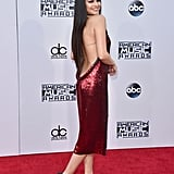 Selena wore a sparkling, high-neck Givenchy dress that bared her lower back at the 2015 American Music Awards. She posed for the cameras from just the right angles, accessorizing simply with Jimmy Choo sandals.