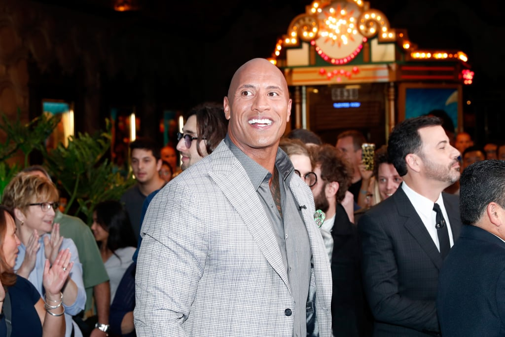 "Dwayne Johnson kicked off his promotional tour for Moana over the weekend, and on Monday, the actor hit the red carpet for the world premiere of the film in LA. Dwayne, who plays the demigod Maui in the movie, was joined by late-night host Jimmy Kimmel and was all about the fans as he snapped selfies and flashed his winning smile.  In addition to his upcoming film, which hits theaters on Nov. 23, The Rock has also been grabbing attention thanks to recent reports that he's this year's People's Sexiest Man Alive. While Dwayne has yet to confirm the speculation, he has been teasing a ""huge surprise"" on Instagram, and even shared a snap of himself at a photo shoot, writing, ""I'm here doing my Charlie Chaplin pose for a 'First ever' cover shoot which will drop next month. It's a huge surprise so I can ruin the magic."" Given the fact that People's Sexiest Man Alive issue hits newsstands on Friday, there's a strong possibility the rumors are true. The news will be revealed on Tuesday, so guess we'll just have to wait and see."