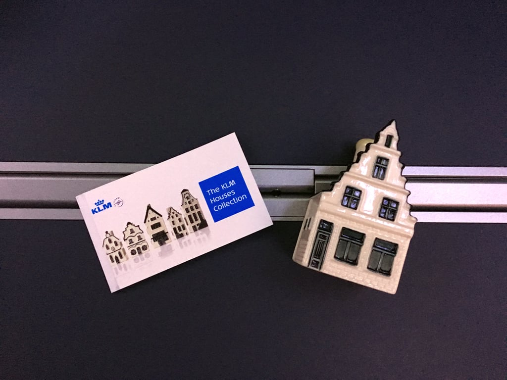I was pretty happy with the entire experience — and then we received our KLM Delft Blue Houses. Given for free in business class, each house is a fun collectible and full of gin! With it, you get a guide to see where your house is in the Netherlands, and to make sure you don't collect the same one again. The story behind the gin dates back to the early days of flying, where airlines were prohibited to give customers extravagant gifts. To work around this, KLM would hand out these houses to people and put gin inside — something no one else would assume just by looking at it. KLM adds a new house each year to mark another year of the company's existence. It currently has 96 houses!  Flying KLM business class on the 787 Dreamliner is truly an unforgettable experience. It's something I would do again — if I had to go on business and my company paid for it. The meals, TV, and fully lie-in seat make the price worth it for anyone who has to get up and head into a meeting after arriving. If anything, the entire experience made me think of a KLM as a friendly airline that truly wants to create loyal customers.