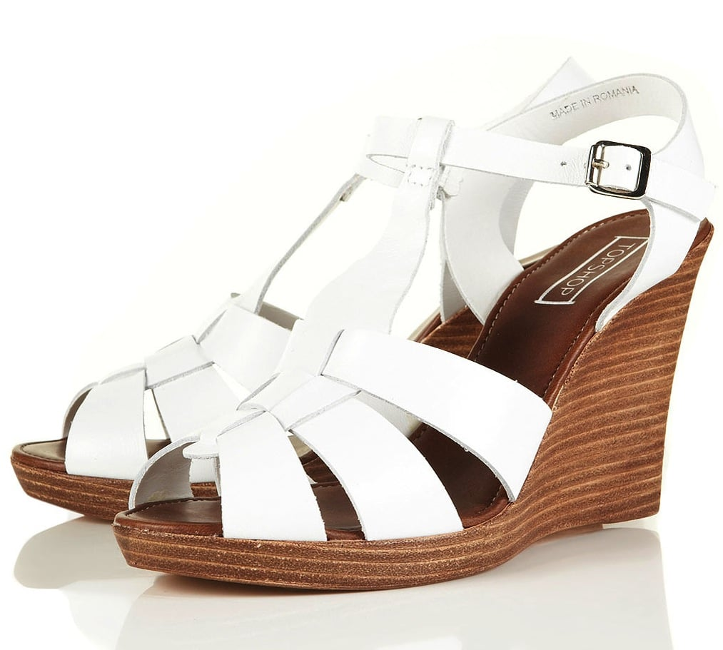 Everyone needs a pair of white T-strap wedges — they go with everything.  Topshop Walcott T-Bar Leather Wedges ($90)